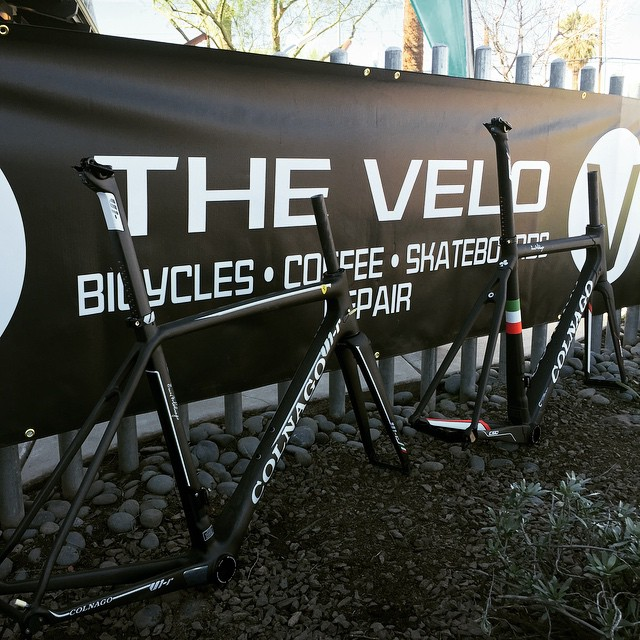 Colnago bicycles in front of The Velo banner